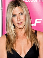 Jennifer Aniston showing cleavage at the Yogalosophy book launch in LA from CelebMatrix