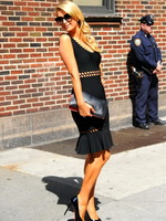 Paris Hilton shows pokies wearing a tight black dress at the Late Show with David Letterman from CelebMatrix