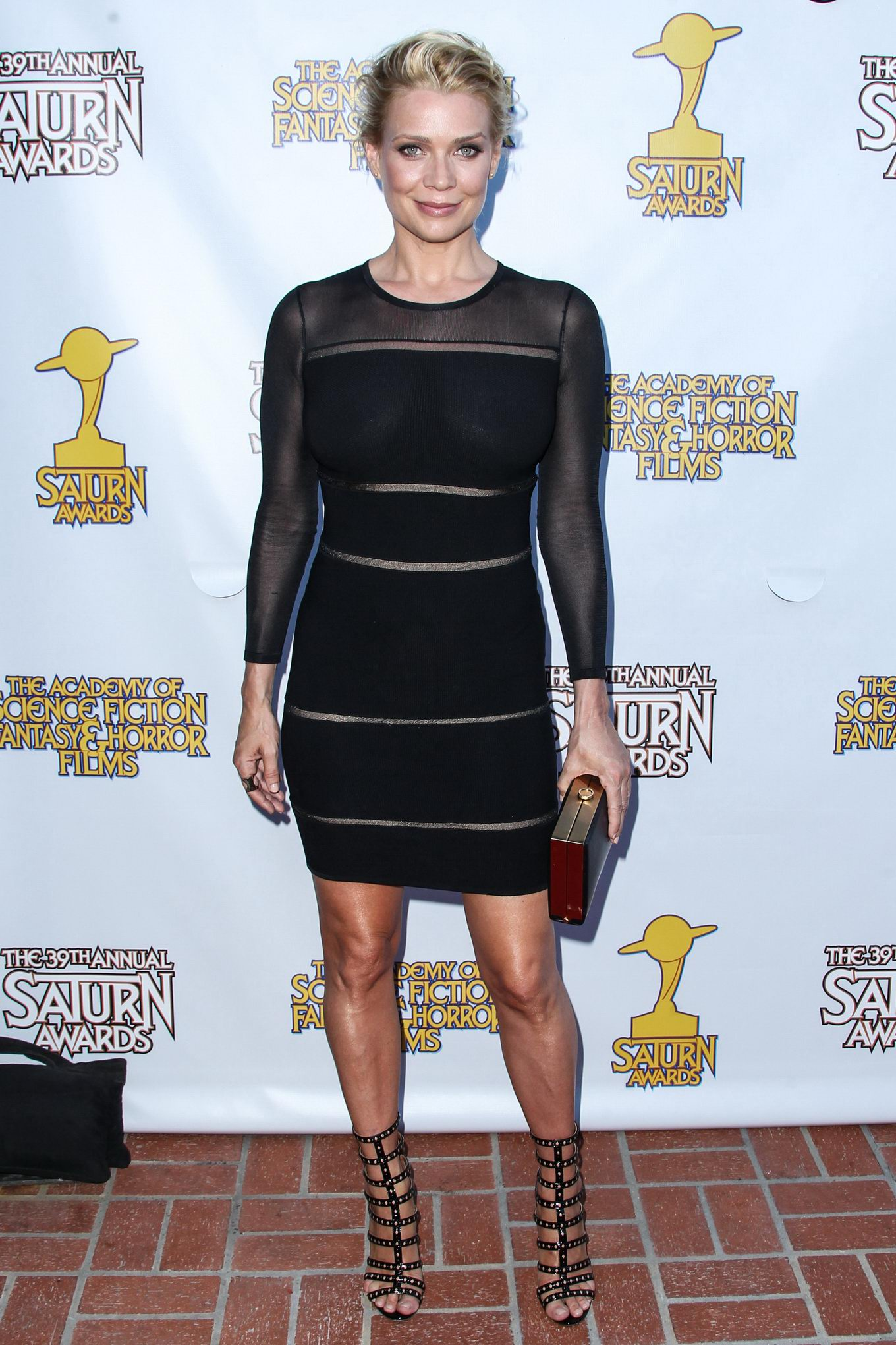 Laurie Holden shows off her boobs wearing a tight ...