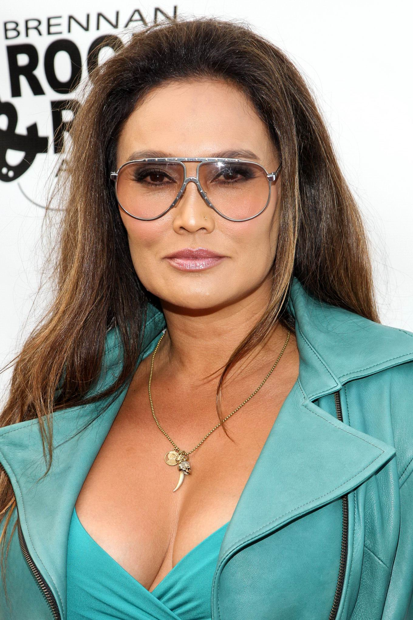 Tia Carrere Shows Huge Cleavage Wearing A Low Cut Dress At -1419