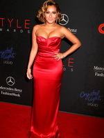 Adrienne Bailon shows off her booty  cleavage wearing a tight red maxi dress at the 2013 Style Awards in NYC