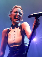 Kylie Minogue in tight latex dress performing on stage in Paris from Celebs Dungeon