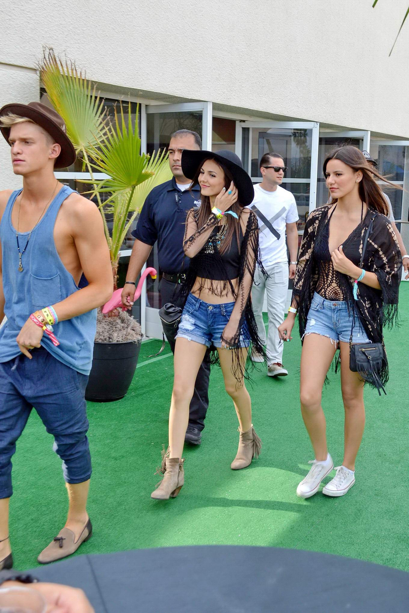 Victoria Justice wearing denim shorts and belly top at the ...