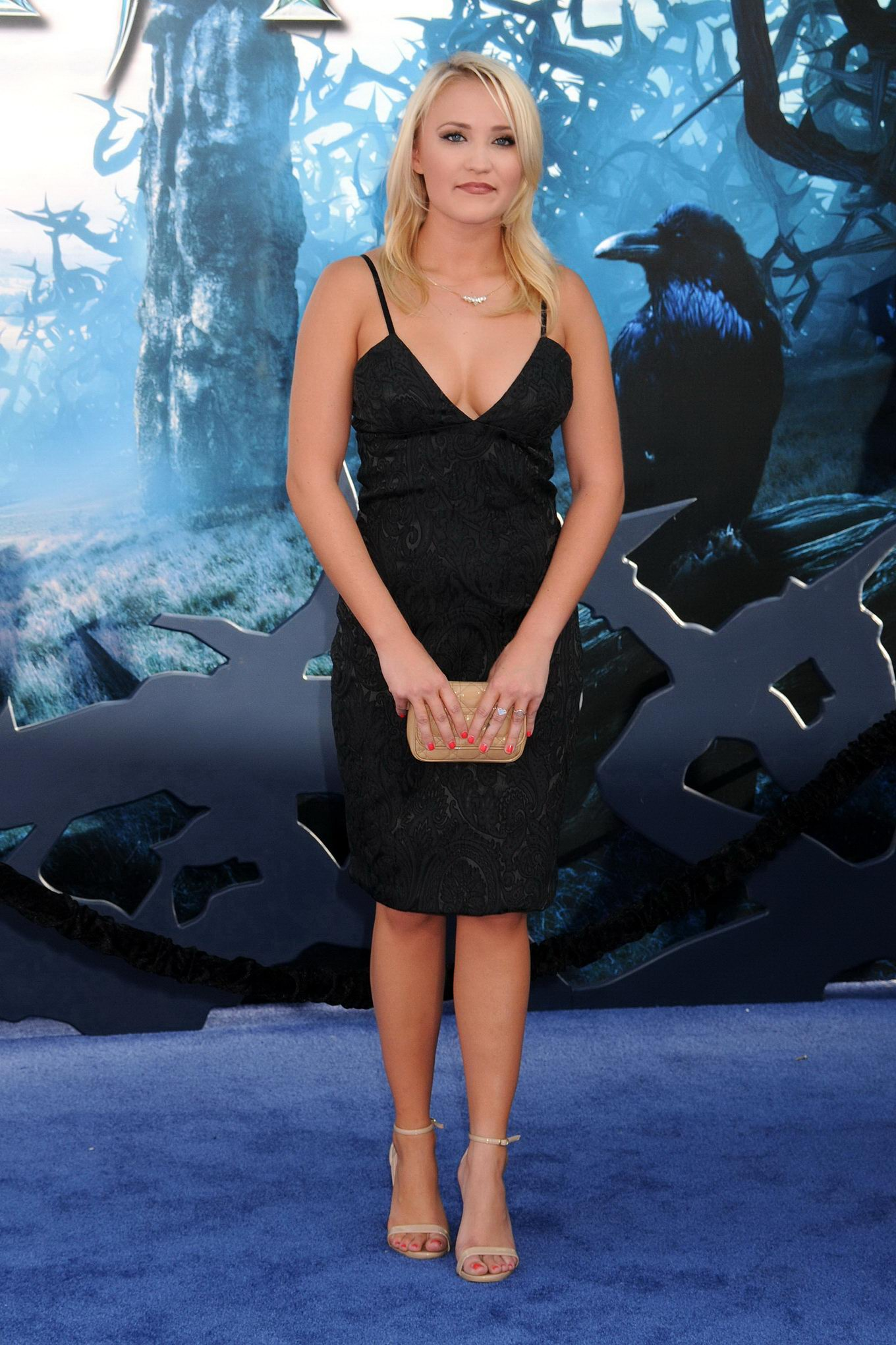 Busty Emily Osment wearing a low cut black dress at the ...