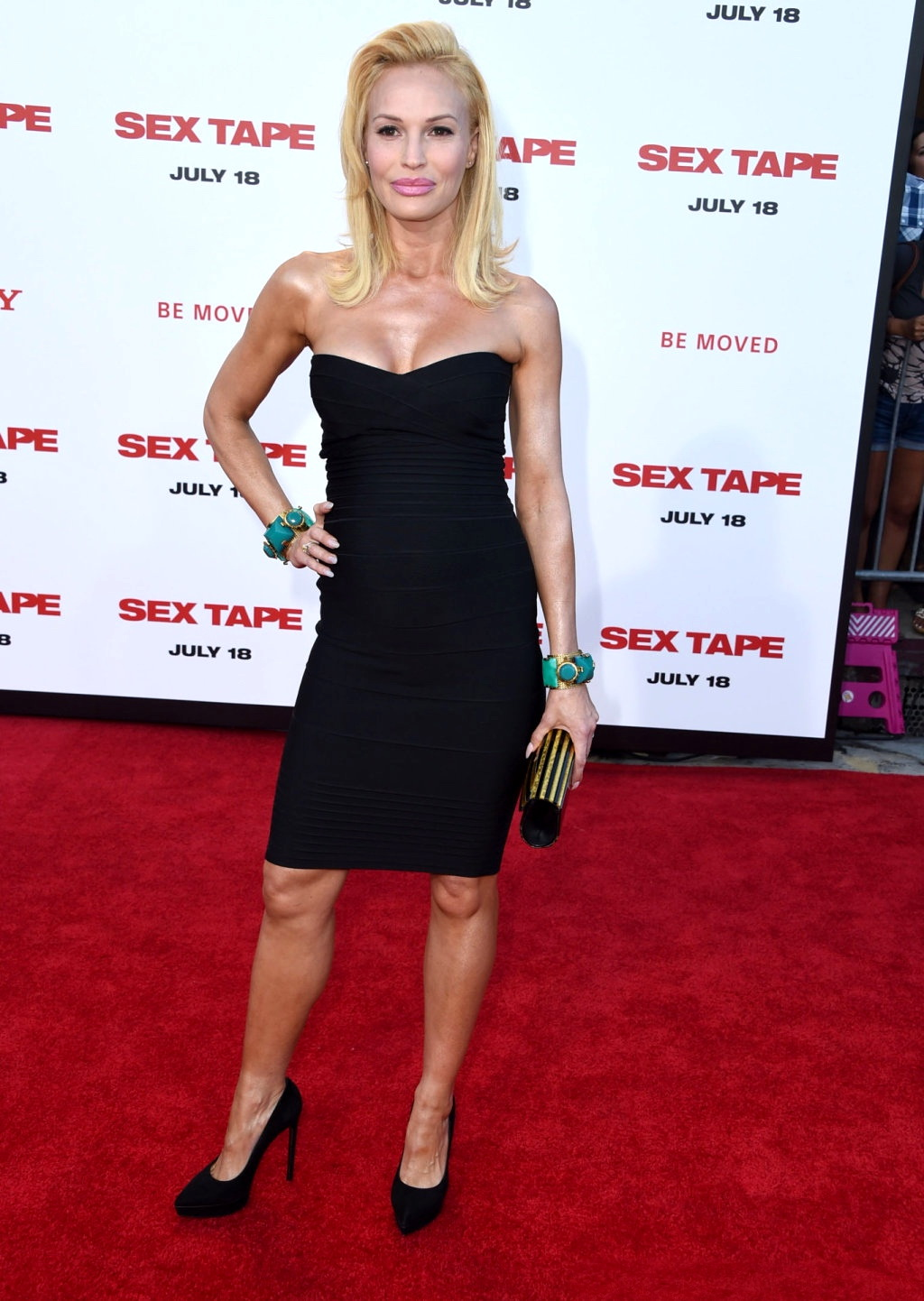 Jolene Blalock pregnant and busty wearing a strapless black dress at the 'Sex Tape' premiere