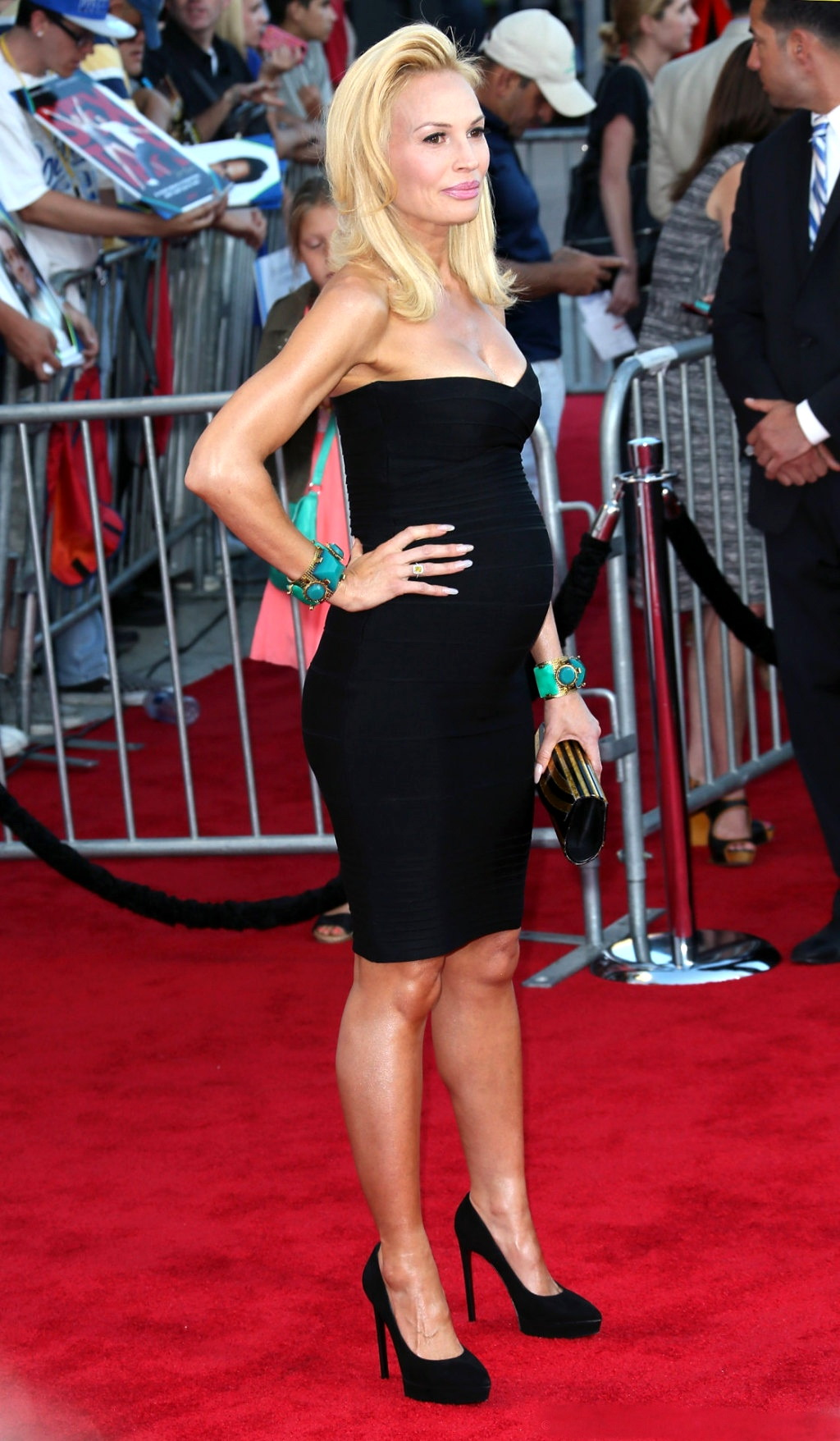 Jolene Blalock pregnant and busty wearing a strapless ...