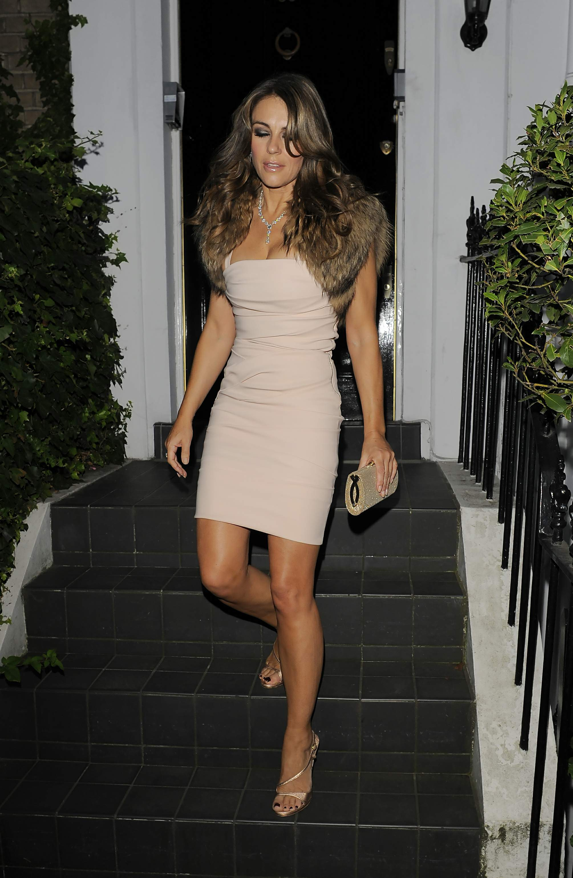 Elizabeth Hurley leggy & cleavy wearing a mini dress on ...