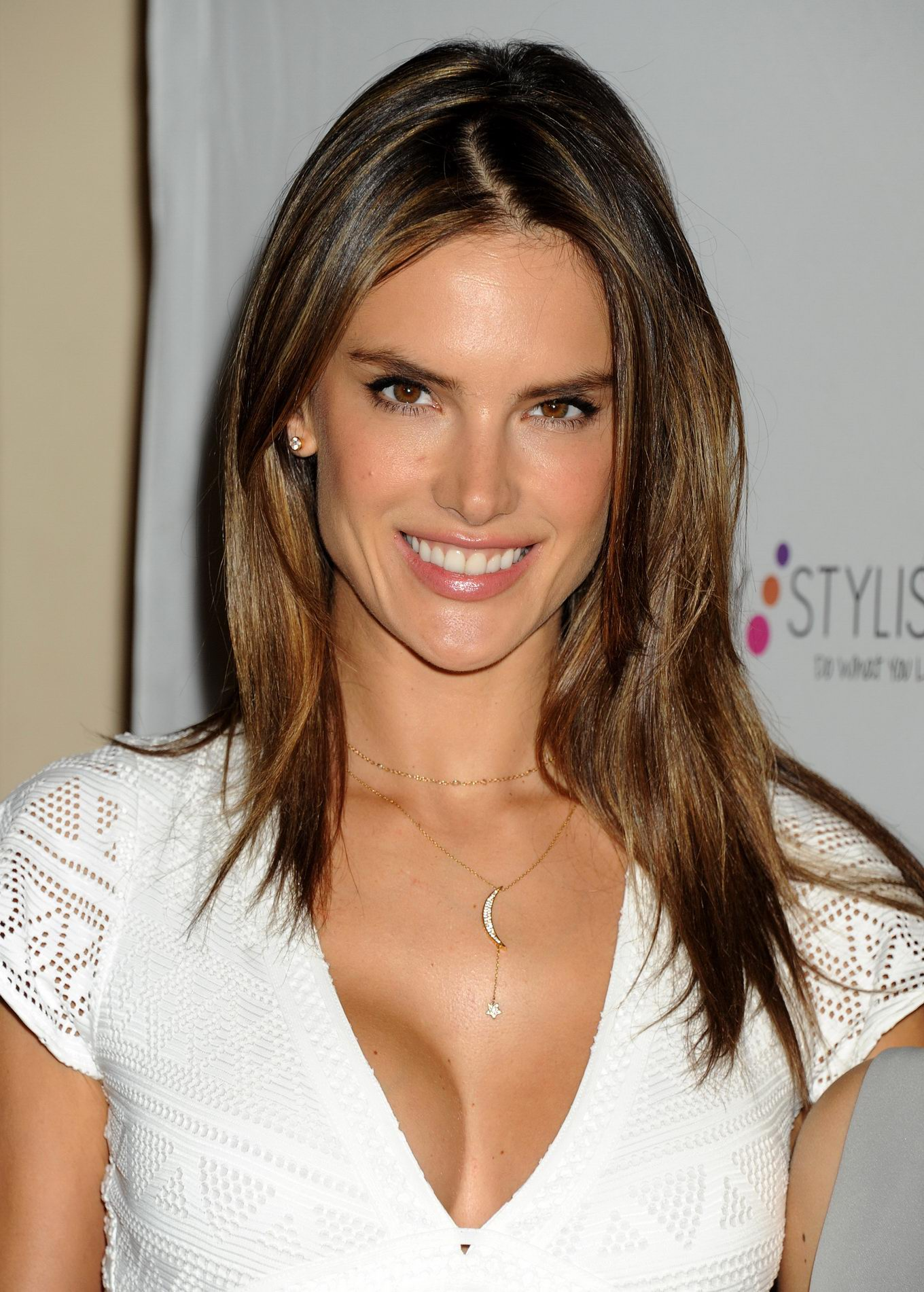 Alessandra Ambrosio shows huge cleavage wearing a white ... Alessandra Ambrosio