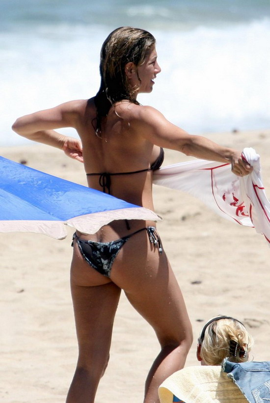 jennifer aniston in hot bikini on a surf board showing us her perfect