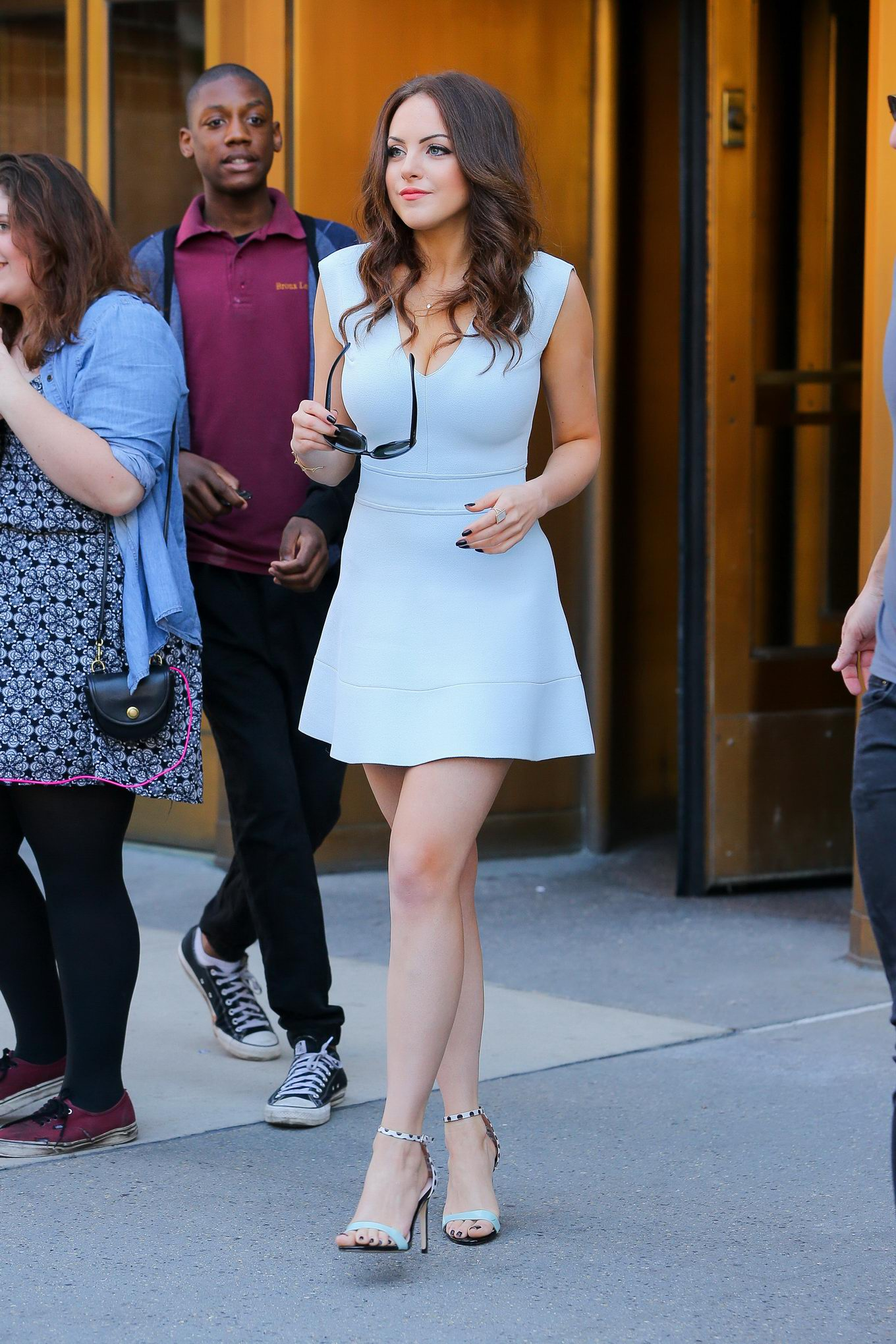 elizabeth gillies showing off her legs and huge cleavage while dealing