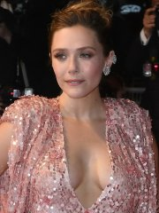 Elizabeth Olsen showing off her big boobs braless in a low-cut pink dress in Cannes