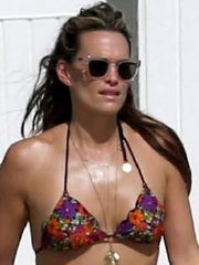 Molly Sims wearing a colorful bikini on a beach in Miami