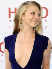 Natalie Dormer braless wearing a huge cleavage dress at the Hugo: Red Never Follows exhibition opening in London