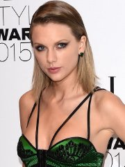 Taylor Swift braless wearing high slit green dress at Elle Style Awards in London