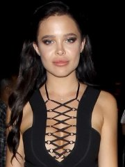 Mara Teigen busty and leggy in black plunging mini dress out in West Hollywood