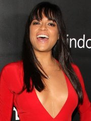 Michelle Rodriguez braless wearing a wide open red dress at amfAR LA Inspiration Gala in Hollywood