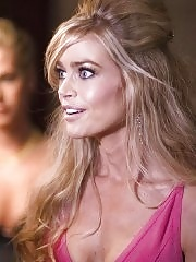 Denise Richards looking very sexy in pink dress