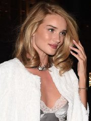 Rosie Huntington-Whiteley showing cleavage outside the Cafe Royal Hotel in London
