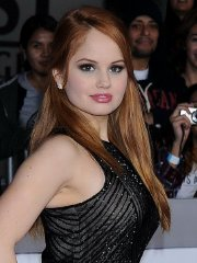 Debby Ryan busty and booty in a tight black dress at Justin Bieber's Believe premiere in LA