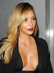 Kim Kardashian braless flaunting her huge boobs in a low cut dress at the Mademoiselle C premiere