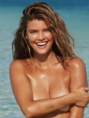 Nina Agdal trying to hide her nude body at the beach for 2014 Sports Illustrated Swimsuit issue