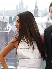 Mila Kunis leggy & shows pokies wearing sexy white dress at the photocall in Moscow