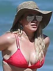 Hilary Duff shows off her big boobs and ass in tiny red bikini at the beach in Mexico
