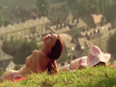 Emily Blunt topless on a hill and getting a tan