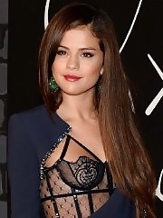 Selena Gomez wearing see-thru lingerie under wide open black dress at 2013 MTV Video Music Awards