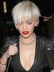 Rita Ora shows off her boobs & pokies braless in black see-thru dress out in Hollywood