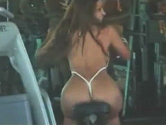Vida Guerra pumps iron and ass in a string bikini showing her ass and tits