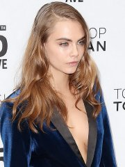 Cara Delevingne braless wearing a wide open jacket at Topshop Topman Flagship Store Grand Opening in NYC