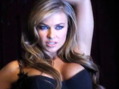 Carmen Electra fills out her lingerie with her meaty boobs in a sexy lap dance onstage