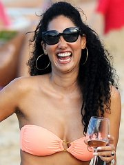 Kimora Lee Simmons wearing a strapless bikini on a beach in St. Barts