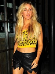 Ellie Goulding in leather shorts and jaguar print belly top leaving Shoreditch House in London
