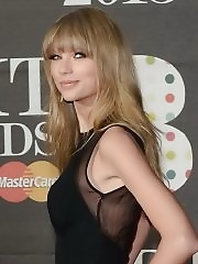 Taylor Swift busty and leggy wearing black partially see-thru dress on 2013 Brit Awards at 02 Arena