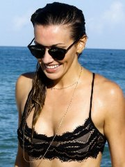 Katie Cassidy tanning her sexy ass in black lace bikini at the beach in Miami