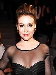 Alyssa Milano braless showing off her huge boobs in sexy dress at Spring 2014 Fashion Show in NYC