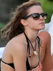 Emma Watson in black bikini petting with her boyfriend on a Carribean beach