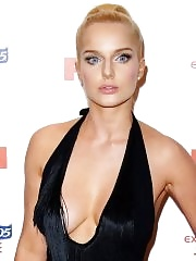 Helen Flanagan braless shows huge cleavage in a black low cut dress at FHM Sexiest Women Awards