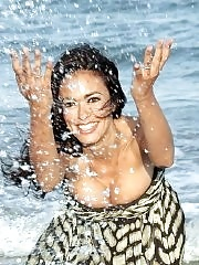 Maria Grazia Cucinotta busty in a low cut summer dress at the beach photoshoot in Venice