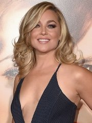 Elisabeth Rohm braless showing huge cleavage in sexy jumpsuit at The Danish Girl premiere in Westwood