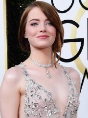 Emma Stone showing huge cleavage braless in sheer lace dress at 74th Annual Golden Globe Awards in Beverly Hills