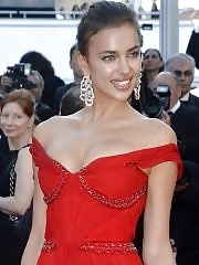 Gorgeus Irina Sheik looks busty and leggy braless in hot red dress at Killing Them Softly premiere