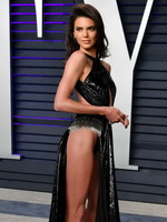 Kendall Jenner braless & pantyless in a tiny black gown at the Vanity Fair Oscar Party in Beverly Hills
