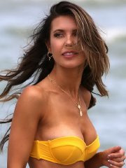 Audrina Patridge near nip-slip in strapless two-piece bikini at the beach in Miami
