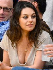 Mila Kunis busty showing huge cleavage at the LA Lakers game in Staples Center