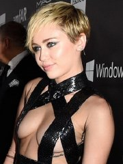 Miley Cyrus see-through covering only nipples at amfAR LA Inspiration 2014 Gala in Hollywood