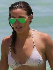 Katie Cassidy showing nipple-pokies in tiny snake-skin bikini at the beach in Miami