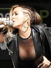 Carmen Electra flaunts her boobs braless in c-thru outfit & stockings while performs at pool party